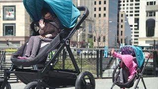 Download Watch Grown-Ups Experience Riding In a Stroller Made Just For Them Video