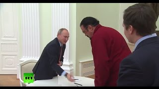 Download Sign Here: Putin presents Steven Seagal with his new Russian passport Video