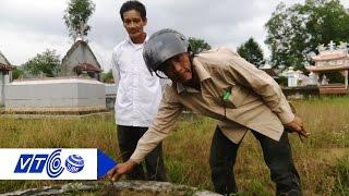 Download Ẩn sâu bên trong những ngôi mộ bị đóng đinh | VTC Video
