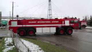 Download ***EXCLUSIVE*** Calgary Police Escort Airport Fire Truck & Airport Authority Sweeper!! Video