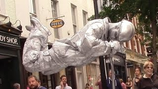 Download Silver man secret revealed London street performer, floating and levitating trick Video