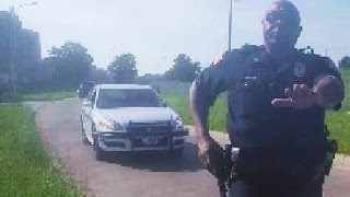 Download WIN - Belligerent Cop Backs Off After Bluffing Video