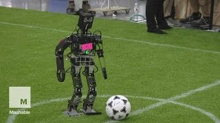 Download Robots playing soccer at RoboCup 2015 is like watching toddlers learn to kick | Mashable Video
