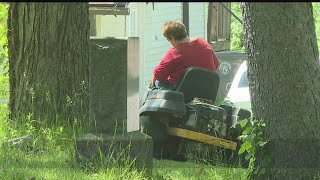 Download Volunteers take care of overgrown cemetery with lawn mowers and trimmers Video