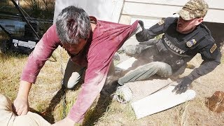 Download WANTED MAN FOUND HIDING UNDER HOUSE! Video