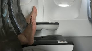 Download Woman on Airplane Says She Watched Passenger Open Window With Bare Feet Video