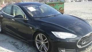 Download Repairing a Flooded Tesla Model S Part one Video