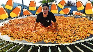 Download TRAMPOLINE VS 1,000,000 PEICES OF CANDY CORN! Video