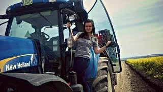 Download Girl driving a New Holland T7060 Video