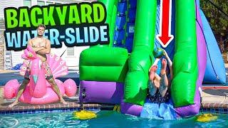 Download Making a BACKYARD WATER PARK!! **MASSIVE** WATER SLIP N SLIDE Video