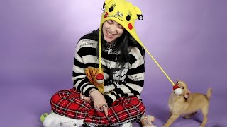 Download Billie Eilish Plays With Puppies While Answering Fan Questions Video