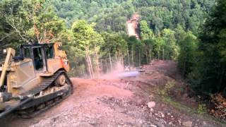 Download Dozers bail off hill on Sheehan pipeline Video