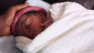 Download Baby refugee born at sea Video