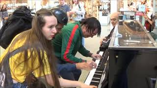 Download Teenage Girl Rocks The Public Piano. Dudes Gather To Watch Video