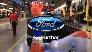 Download Car Workers and Robots Work Hand-in-Hand Video