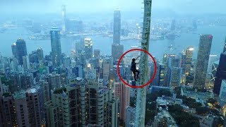 Download sneaking past workers to climb HUGE antenna spire Video