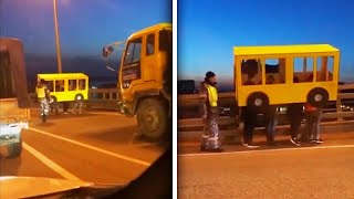 Download People Disguised as Bus Try to Cross Vehicles-Only Bridge on Foot Video