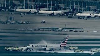 Download Plane catches fire at Chicago's O'Hare Airport Video