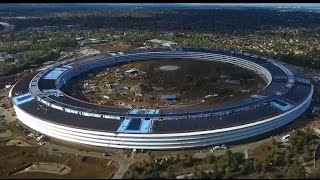Download New drone footage captures construction of Apple's new 'spaceship' HQ Video