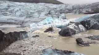 Download Iceberg Covered with Volcanic Ash Breaking Off from Svinafellsjokull Glacier in Iceland - AMAZING! Video