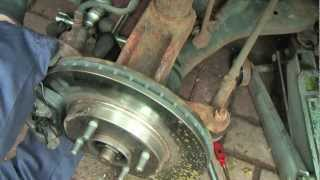Download Ford focus brake pads and disc change and a helicoil thread repair to slider bolt retaining hole Video