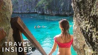 Download Lagoon Hidden Behind Limestone Cliffs In The Philippines Video
