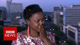 Download Mugabe resigns: activist breaks down in tears of Joy - BBC News Video