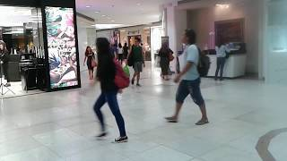 Download BUSY FOOT TRAFFIC ON A MALL HALLWAY INTERSECTION Video