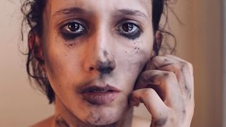 Download Activist confronts social issues with makeup Video