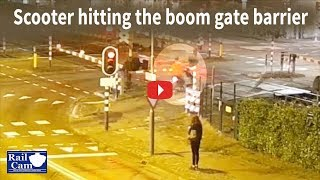 Download Scooter hitting boom gate barrier on RailCam crossing Video