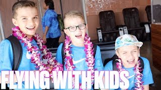 Download FLYING ON AN AIRPLANE FOR SEVEN HOURS WITH FOUR KIDS | FIRST FAMILY FLIGHT TO HAWAII Video