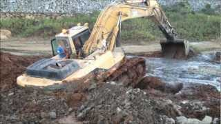 Download Will he ever get this excavator out? Video