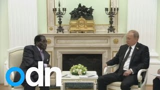 Download Putin and Mugabe make jokes about sanctions at a meeting in Russia Video