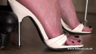 Download White Stiletto Heels At The Table Video