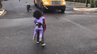 Download Sister Runs to Give Big Brother a Hug as He Gets Home from School Video