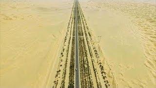Download لماذا بني الصينيون 446 كم من طريق سريع في وسط صحراء مهجورة Video