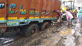Download Tata 2518 Truck Stuck During Rainy Days Pushed By New Jcb 3dx. Video
