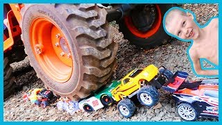 Download Crushing RC Cars With a Tractor! Video