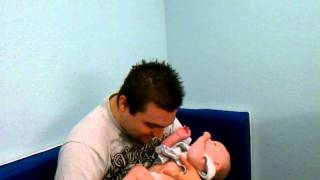 Download Daddy's beard tickles baby's belly Video