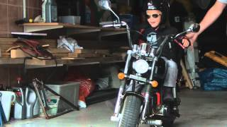 Download 2 year old girl rides her own Harley to daycare Video