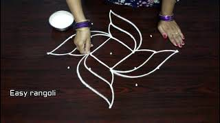Download creative rangoli designs with 7x1 dots , simple kolam designs with dots , muggulu designs Video