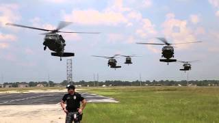 Download Army Black Hawk Helicopters Landing at Johnson Space Center Video