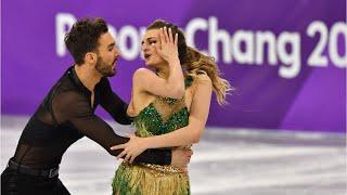 Download French Figure Skater Finishes Despite Wardrobe Malfunction Video