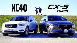 Download 2019 Volvo XC40 vs 2019 Mazda CX-5 Turbo // Attack of the Compacts Video