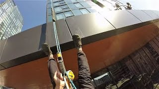Download Rope access window cleaning with rigging and lots of the drop. Video