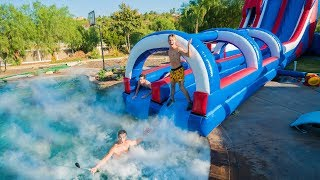 Download GIANT BACKYARD WATERSLIDE INTO 1,000 POUNDS OF DRY ICE! Video