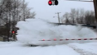 Download 80MPH Amtrak trains plowing snow Video