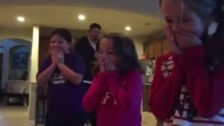 Download Parents Surprises Daughters with Adopted Brother Under The Christmas Tree Video