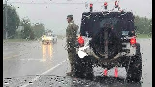Download Soldier Stands At Attention In Pouring Rain. When She Sees Why She Breaks Down In Tears Video