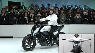 Download Honda Defying gravity By new self-balancing motorcycle at CES 2017 Video